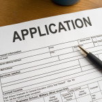 How do property managers choose between applicants?