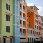 How many people are needed to manage a 120-unit property?