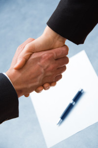 Must a property management agreement be a written contract?