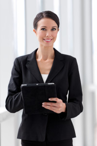 Businesswoman with Digital Tablet Computer in Office